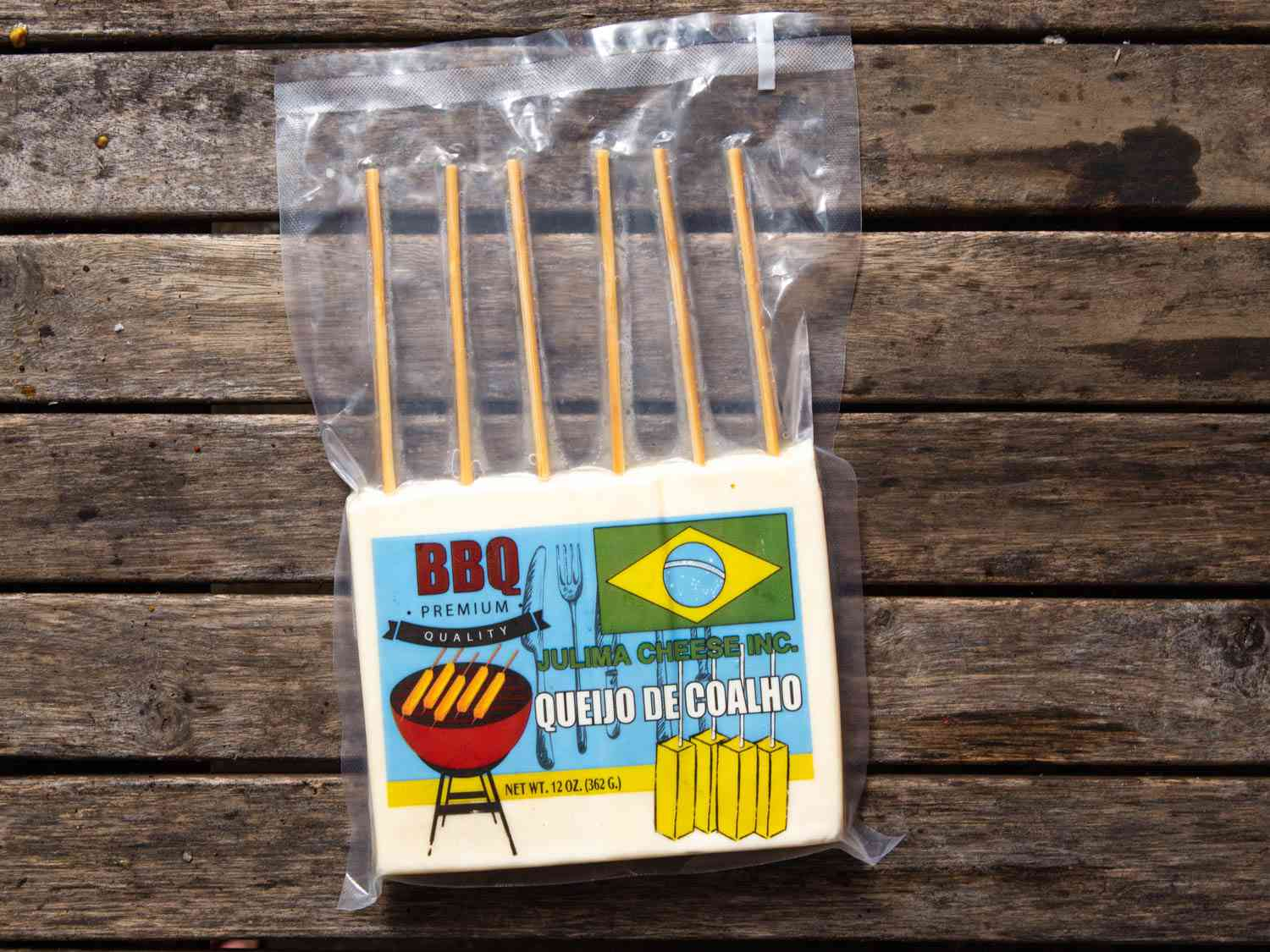 A shrink-wrapped package of queijo coalho em espetos, Brazilian cheese skewers, on a table