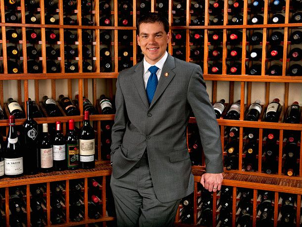 Sommelier surrounded by bottles of wine