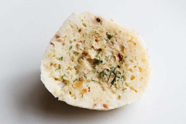 Half of a cooked chicken-stuffed matzo ball, with filling visible