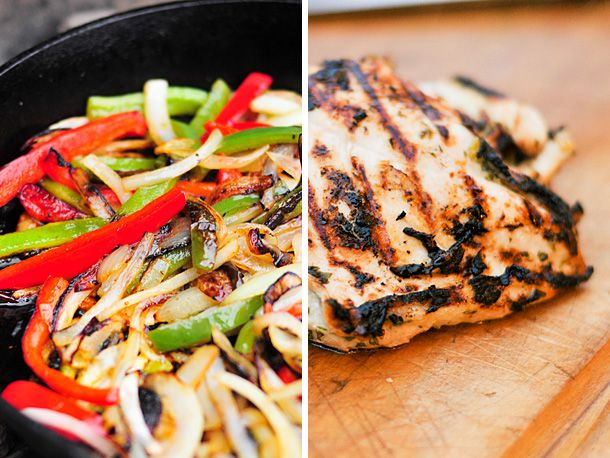 Sliced peppers and onions cooking in a cast iron skillet and a piece of grilled skinless chicken.