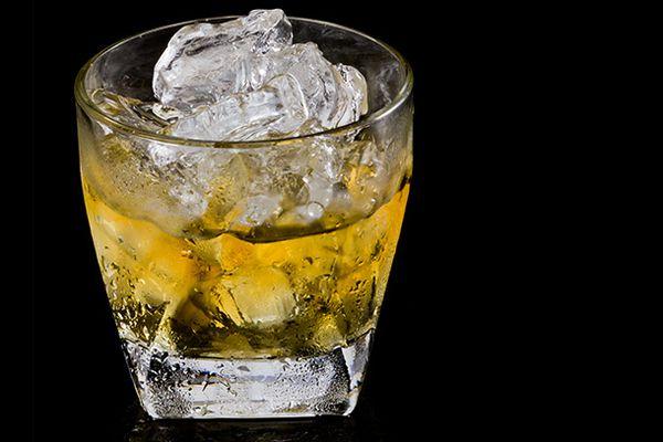 A glass of Irish whiskey on the rocks.