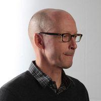 A headshot of John Birdsall, a contributing writer at Serious Eats.