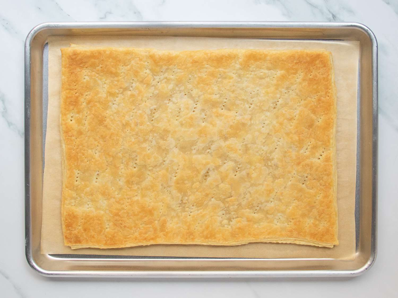 Sheet of par-baked puff pastry set in rimmed baking sheet