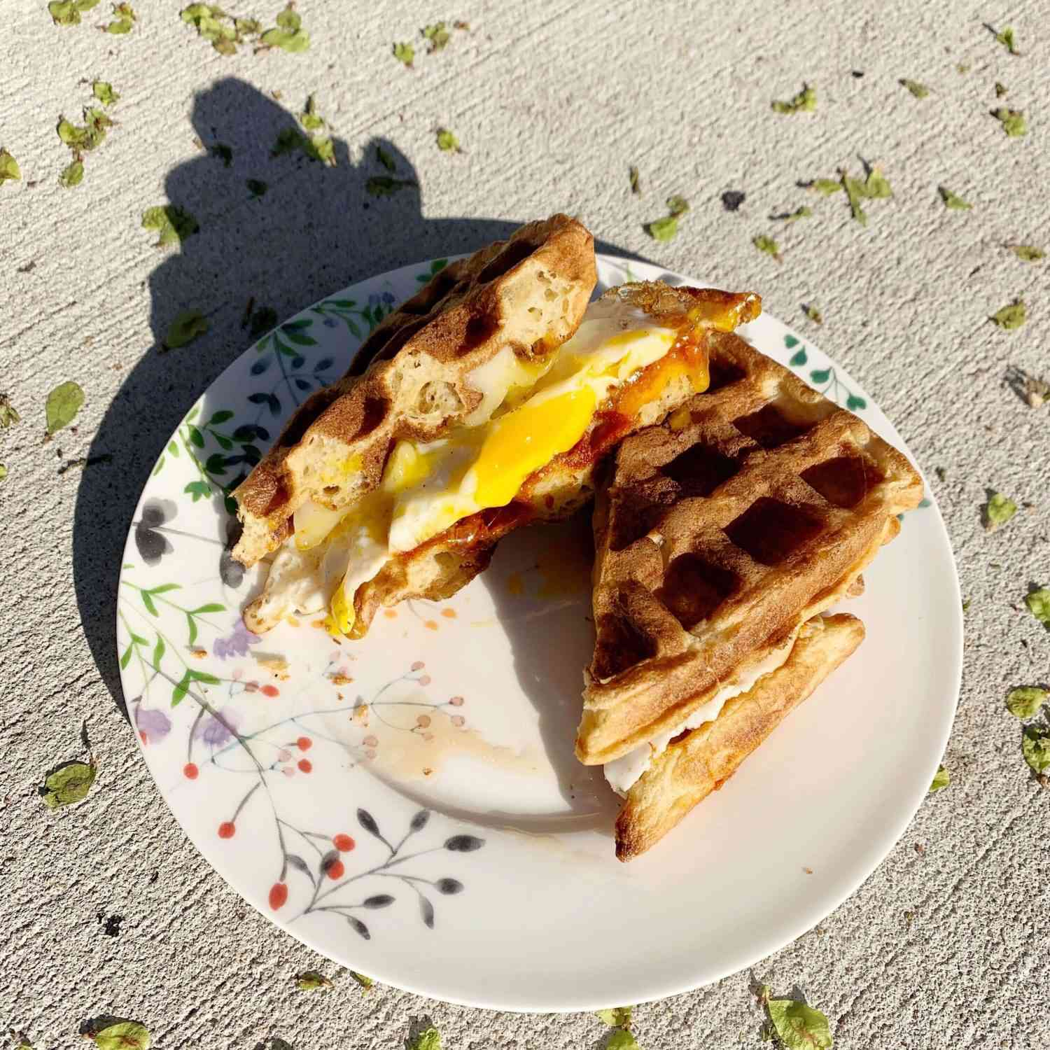 Waffle breakfast sandwich with egg and cheese