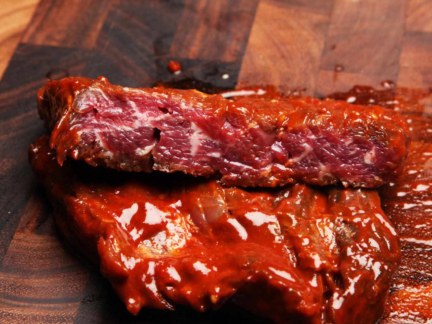 A marinated steak cut in half to reveal the small depth to which the marinade had penetrated.
