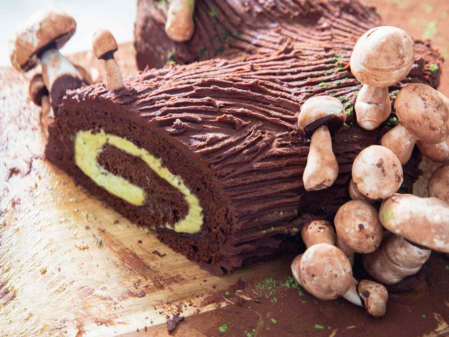 A chocolate and pistachio yule log with meringue mushrooms