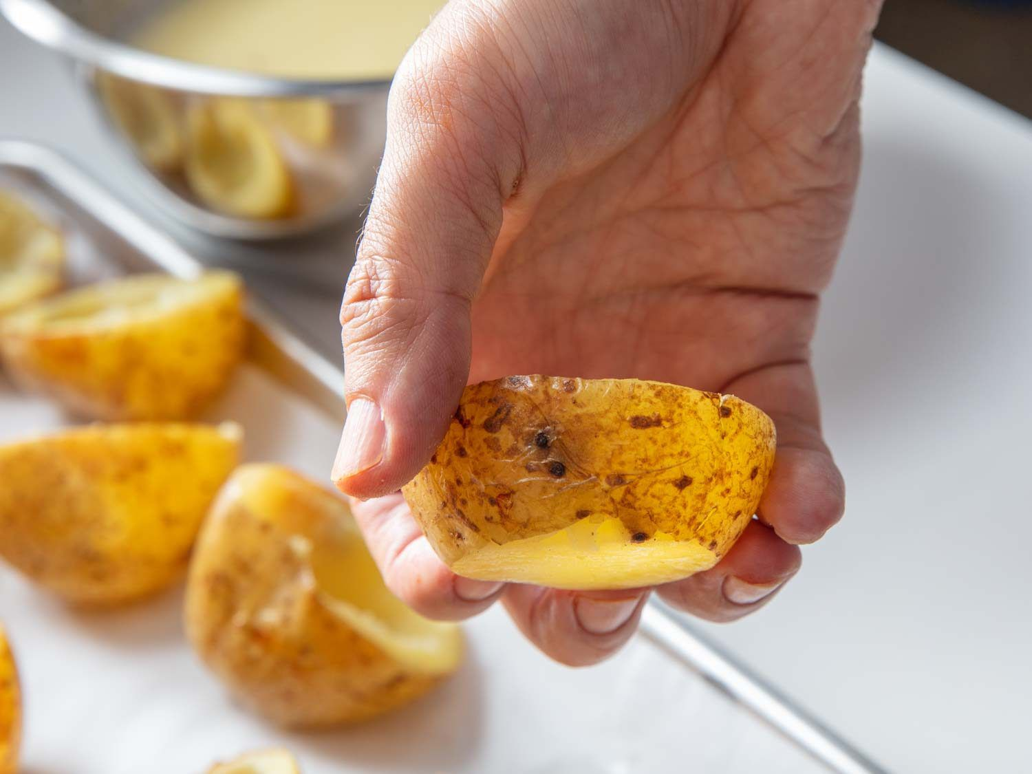 If you want your potato skin cups to sit flat, you can level off their bottoms, as shown in the example in this photo.