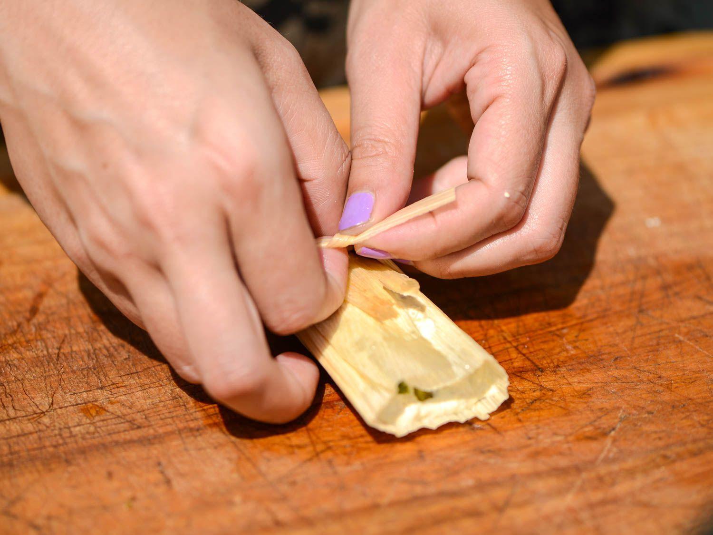 tying tamales