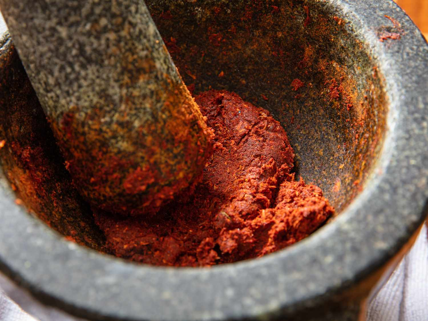 a close up of massaman curry paste in a mortar and pestle