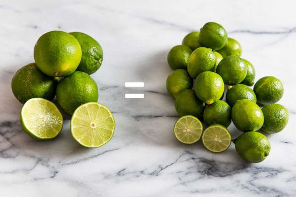 A pound of Persian limes on the left and a pound of Key limes on the right; they are on a marble countertop.
