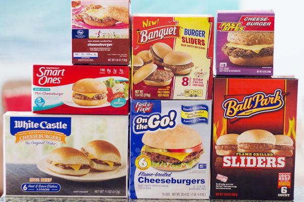 Assorted boxes of frozen hamburgers and cheeseburgers.