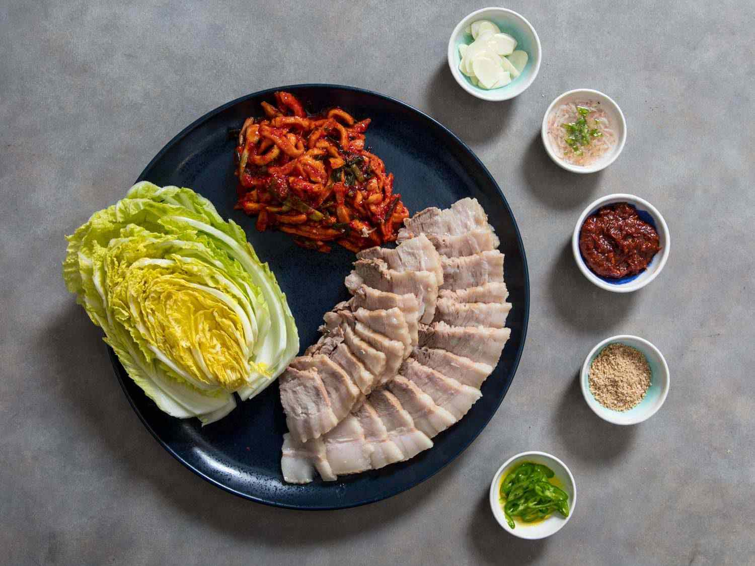 A Korean bossam feast with all the condiments, sauces, and flavorings