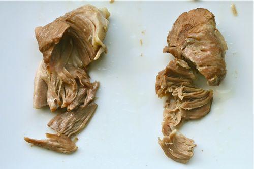 Side-by-side image showing pork shoulder cooked in lard (left) and stock (right).