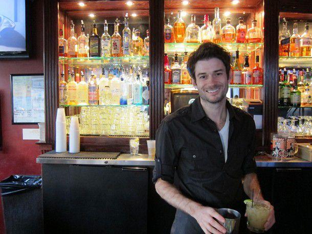 Bartender behind the bar
