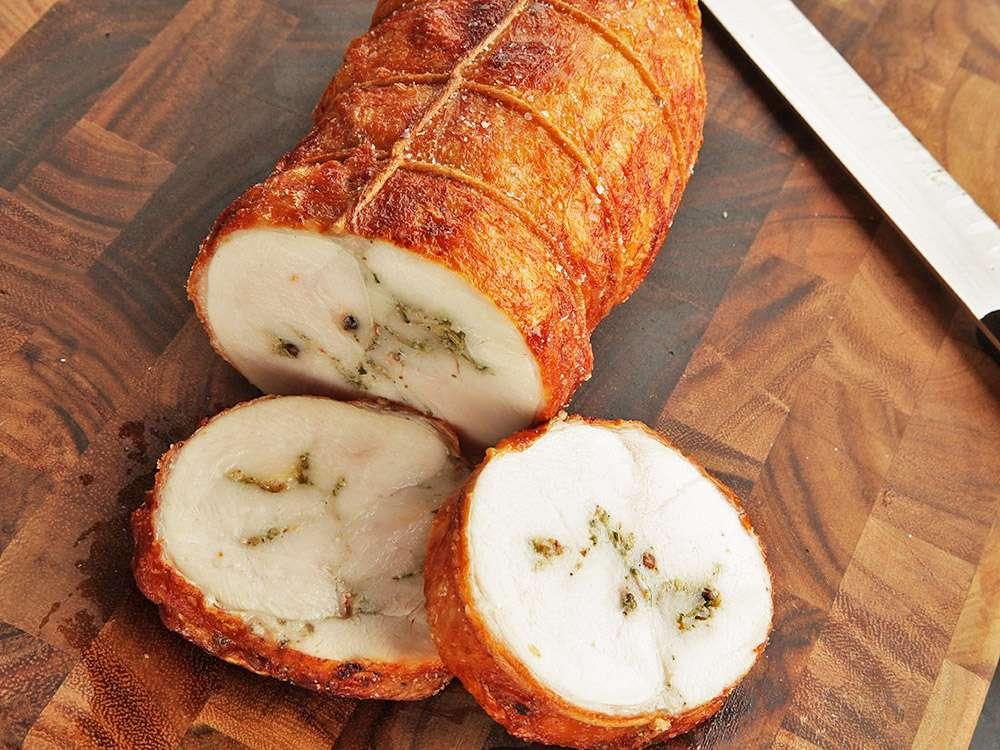 sliced deep-fried turchetta on cutting board