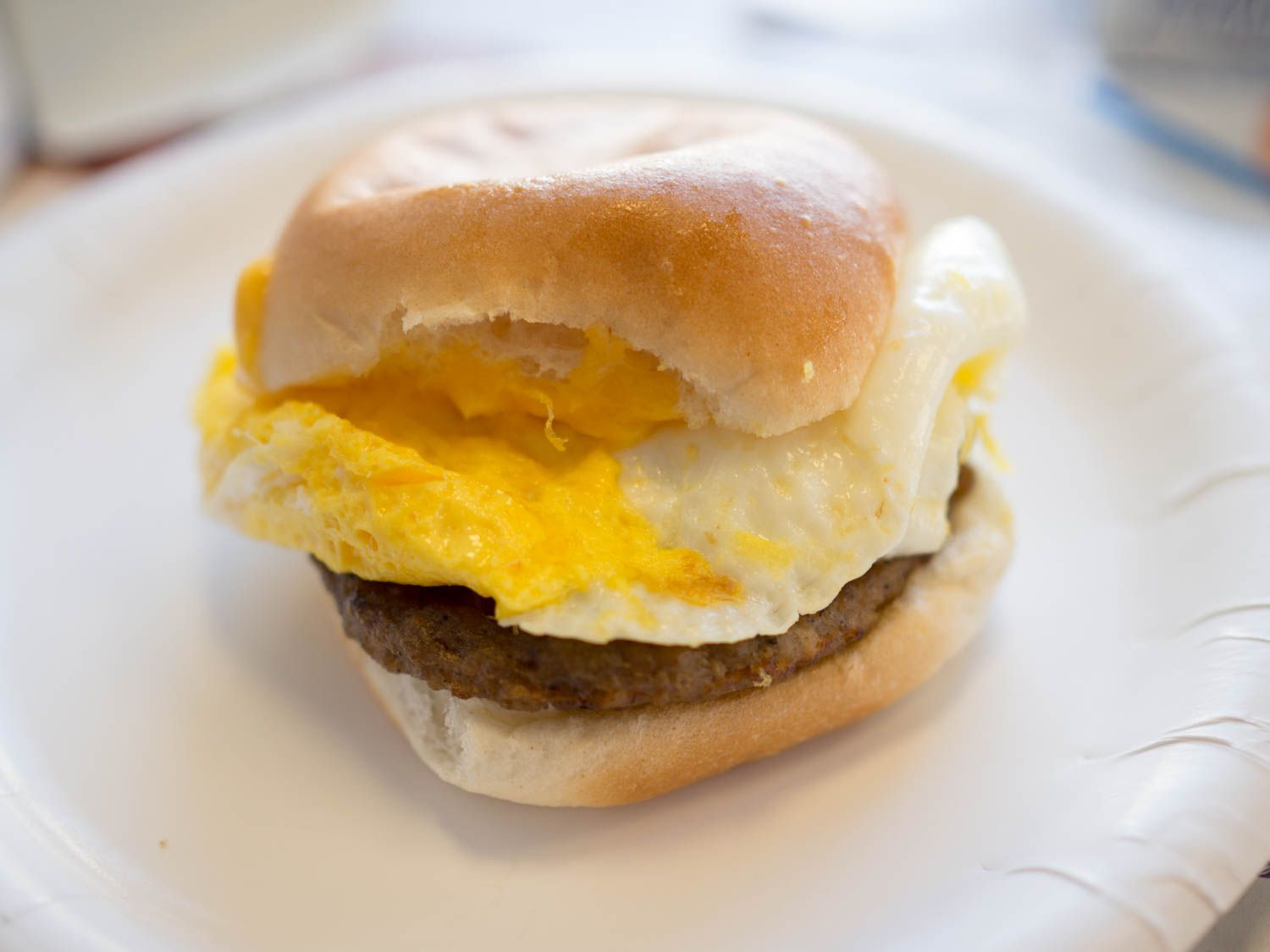 An egg sandwich from White Castle on a paper plate