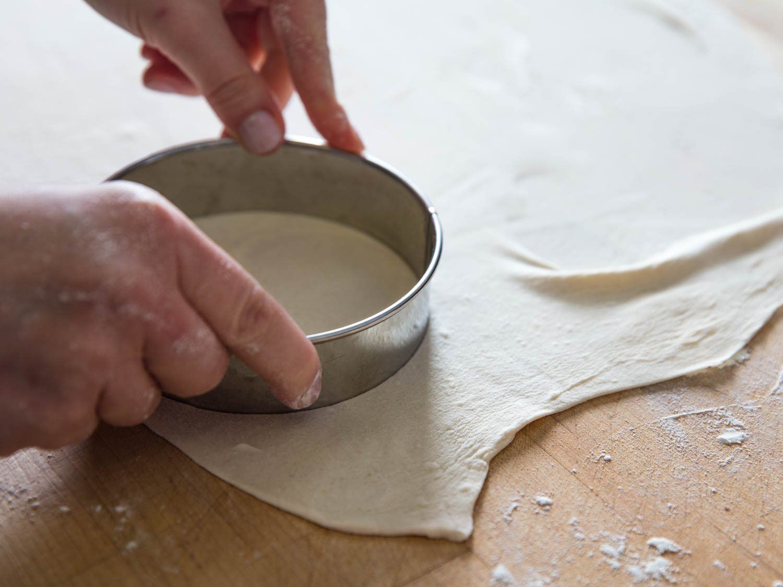 Cut homemade cannoli dough into rounds