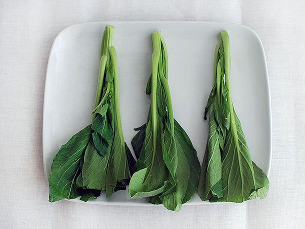 A plate with raw choy sum.