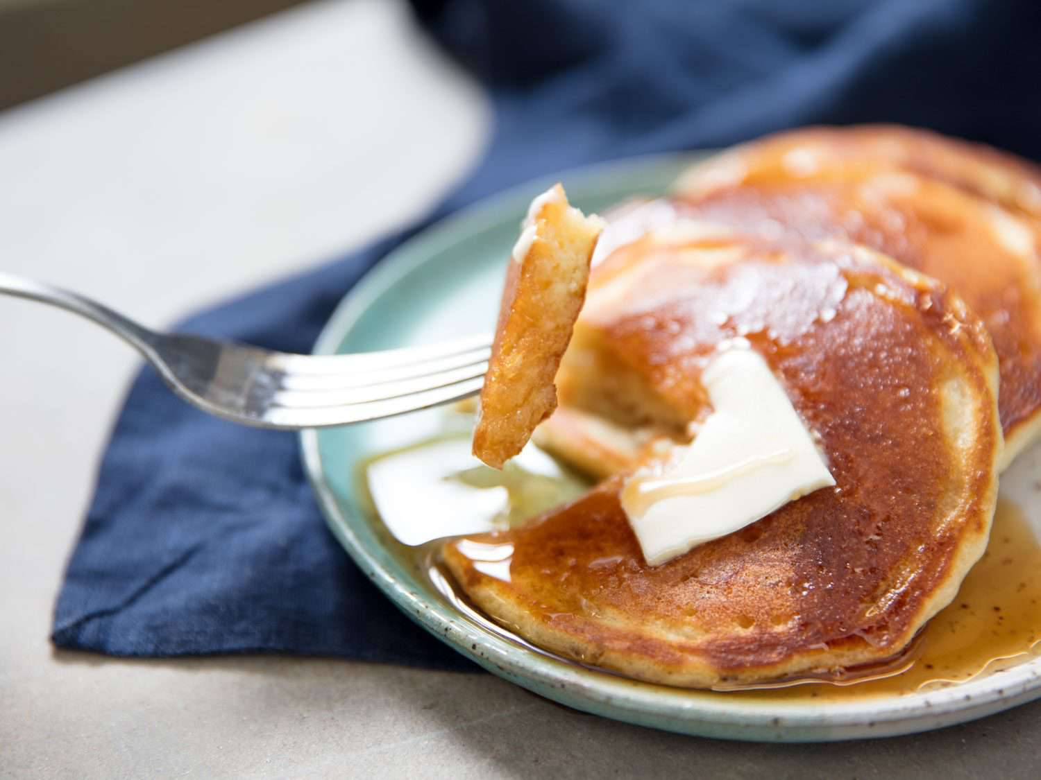 thin pancakes, drenched in syrup