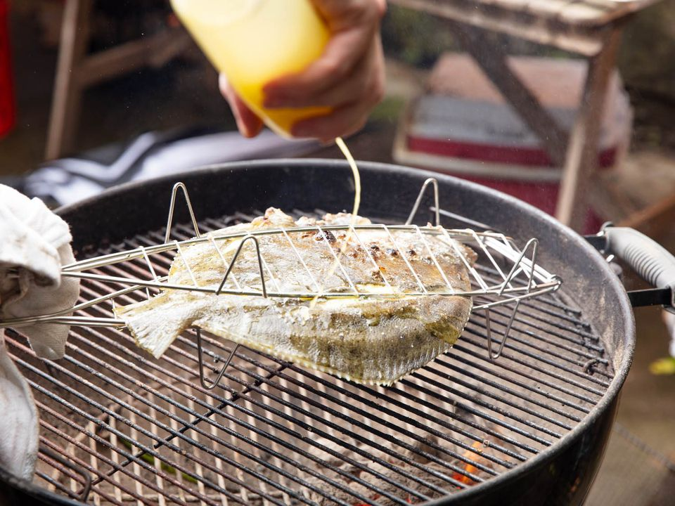 Drizzling vinaigrette on turbot as it cooks on the grill, which keeps the skin from drying out.