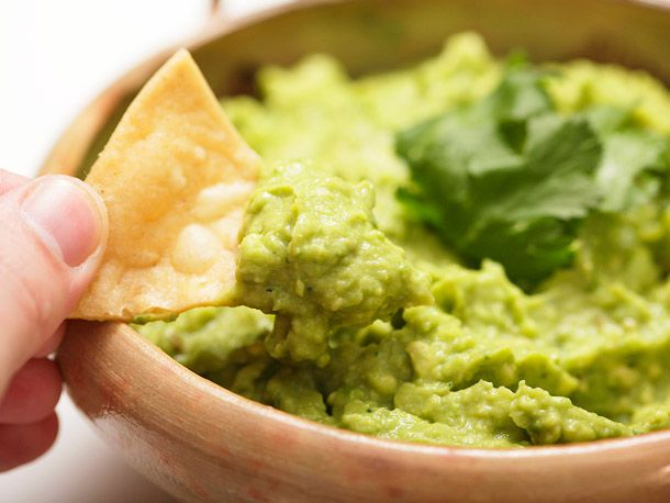 Tortilla chip loaded with guacamole