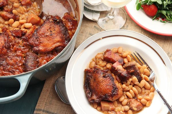 French cassoulet served out of a Dutch oven and onto a plate.