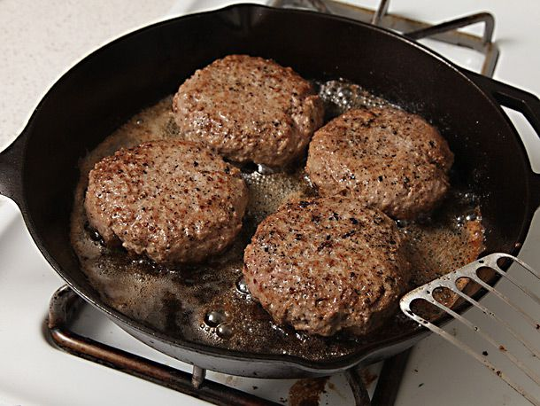 cooked burgers in cast iron skillet