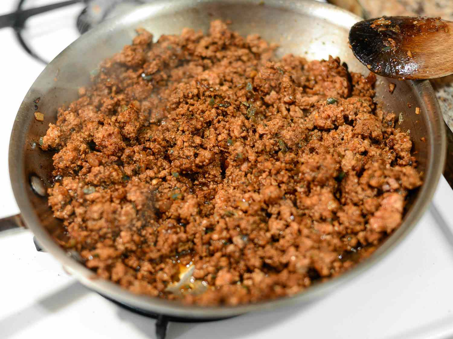 20150414-puffy-tacos-filling-browned-beef-joshua-bousel.jpg