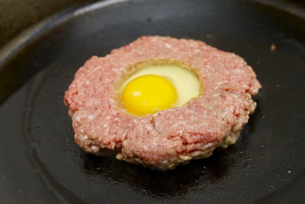 fried egg in middle of burger patty