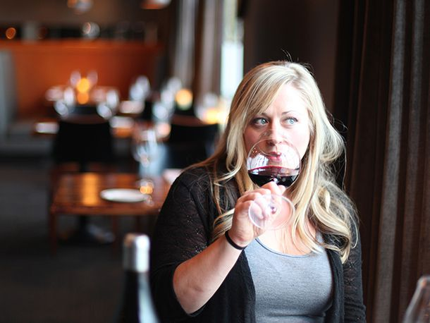 Sommelier drinking glass of red wine