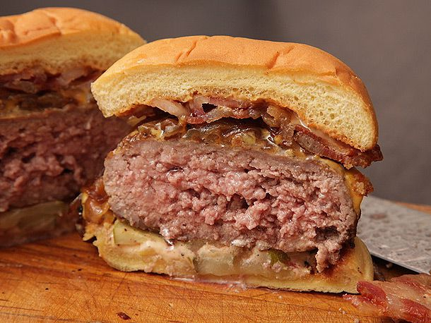 bacon cheeseburger with onions cut in half