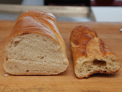 A picture of a soft French grocery store loaf next to a crusty baguette.