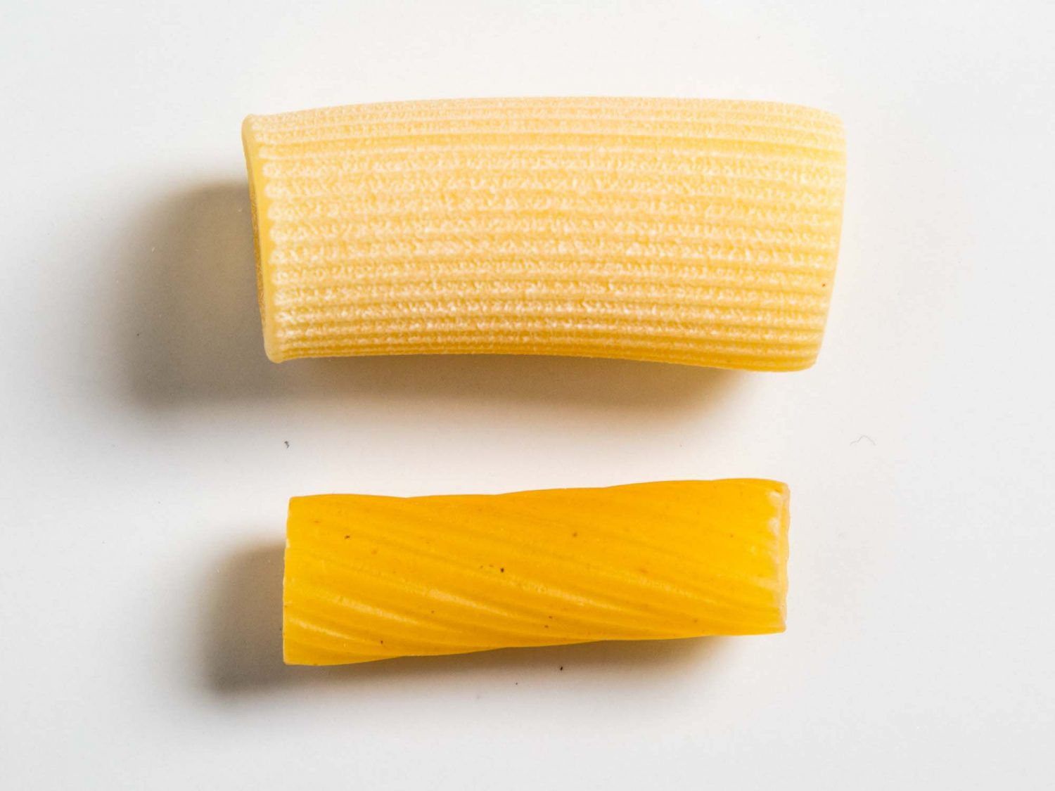 The difference between two dried pasta noodles.