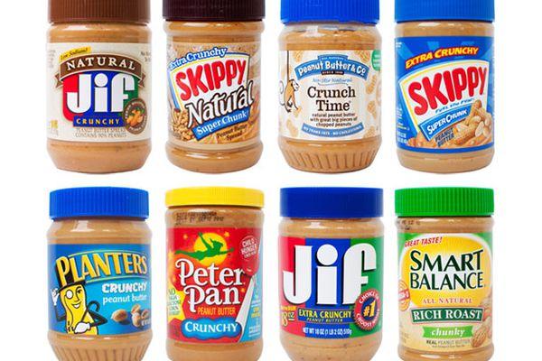 An assortment of different brands of no-stir crunchy peanut butters.