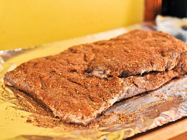 A cured brisket coated with spice rub.