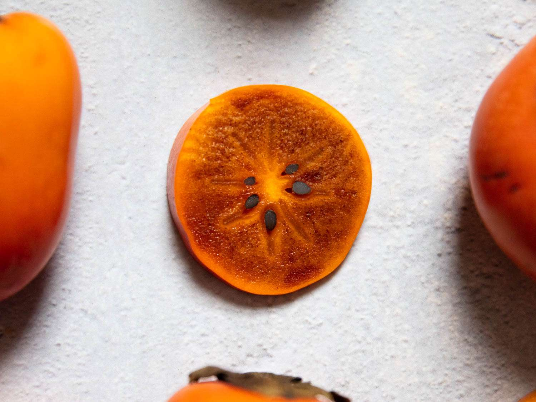 a close up of a slice of a tsurunoko persimmon
