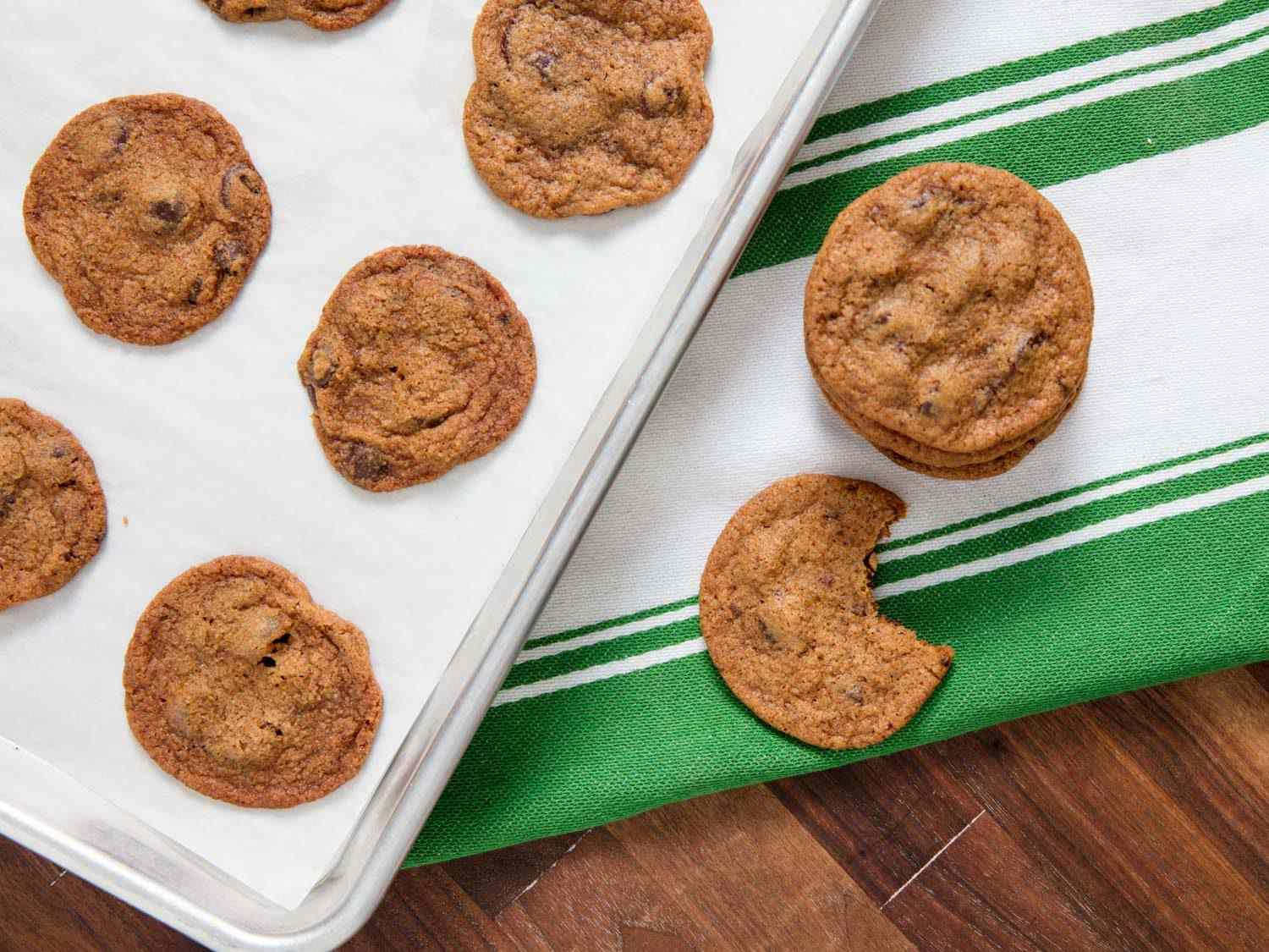 thin chocolate chip cookies on a baking sheet