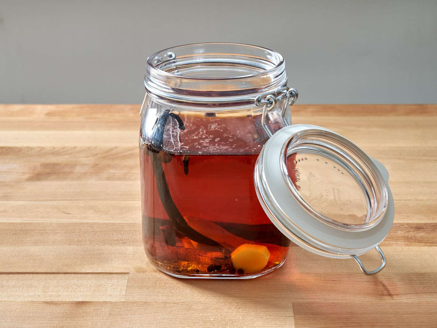 a jar filled with ingredients to make spiced rum