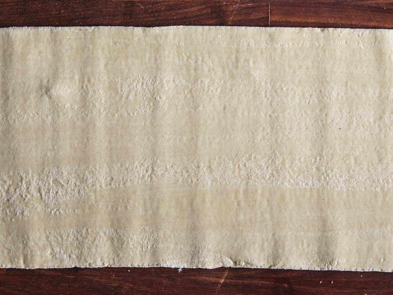 Close up of ramen dough sheet showing horizontal striping