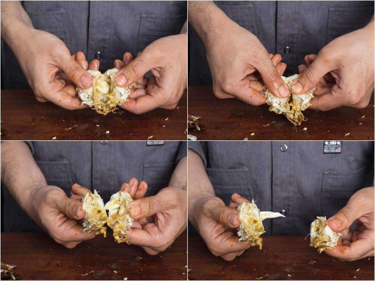 Opening up half of the bottom shell of a crab and exposing the meat