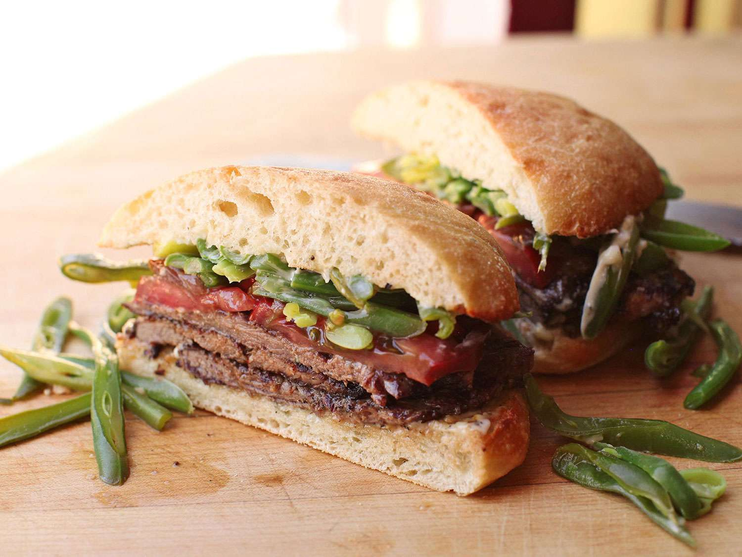 Chacareros chilenos (steak sandwiches topped with tomato and cooked green beans)