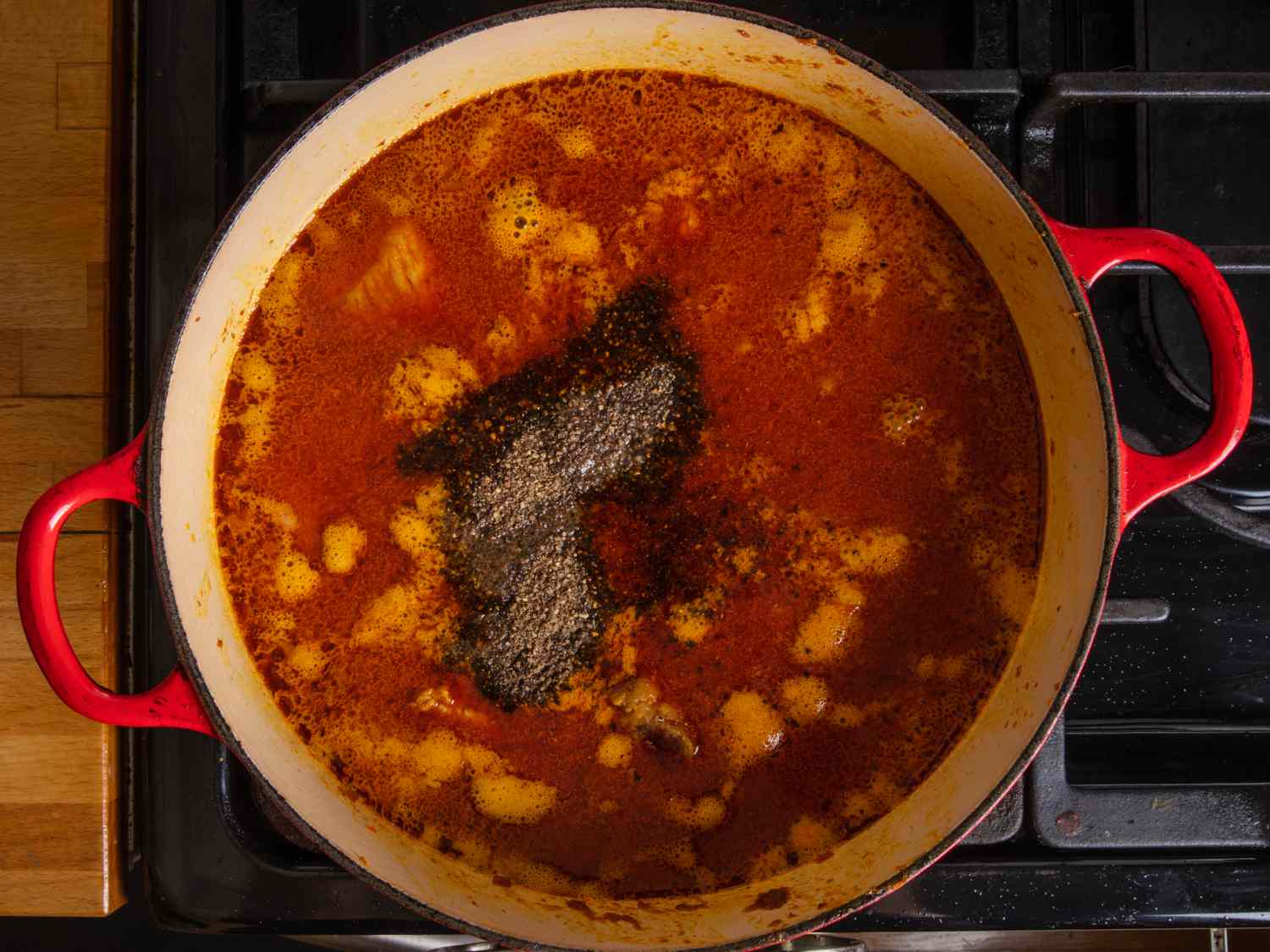 black pepper, fish sauce, and sugar added to pot
