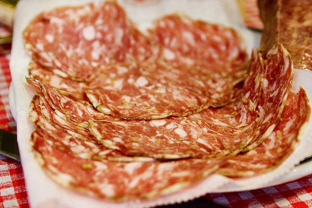 Thinly sliced charcuterie on butcher paper