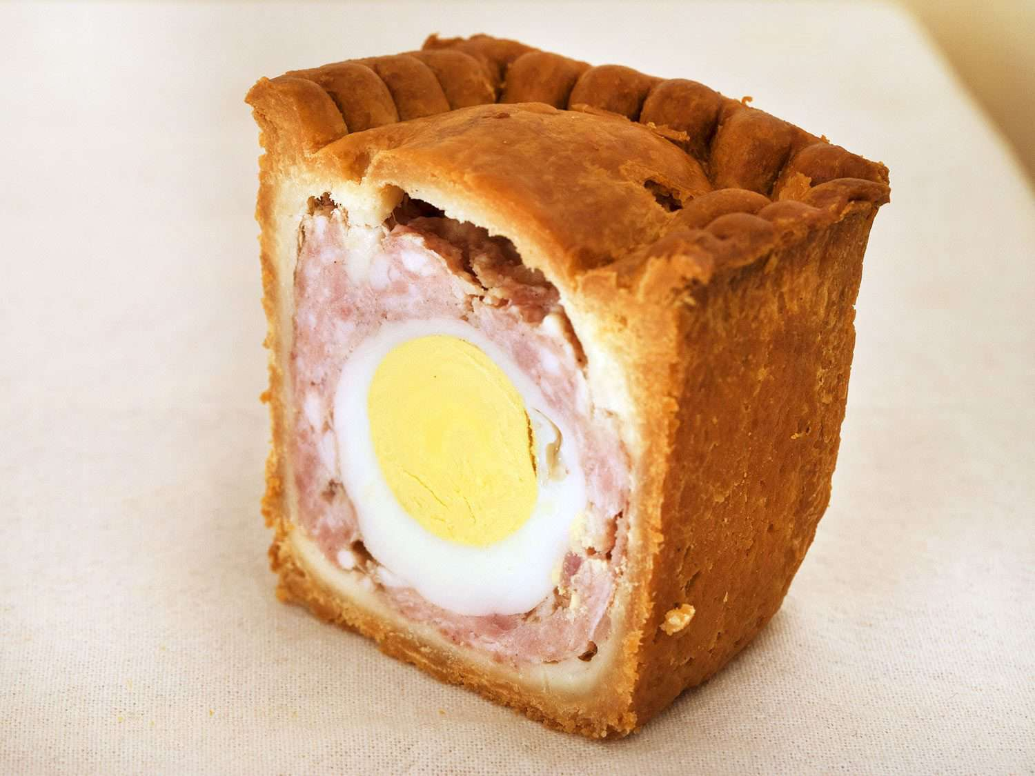 Interior of a gala pie, showing the meat filling surrounding the hard-boiled egg at the center