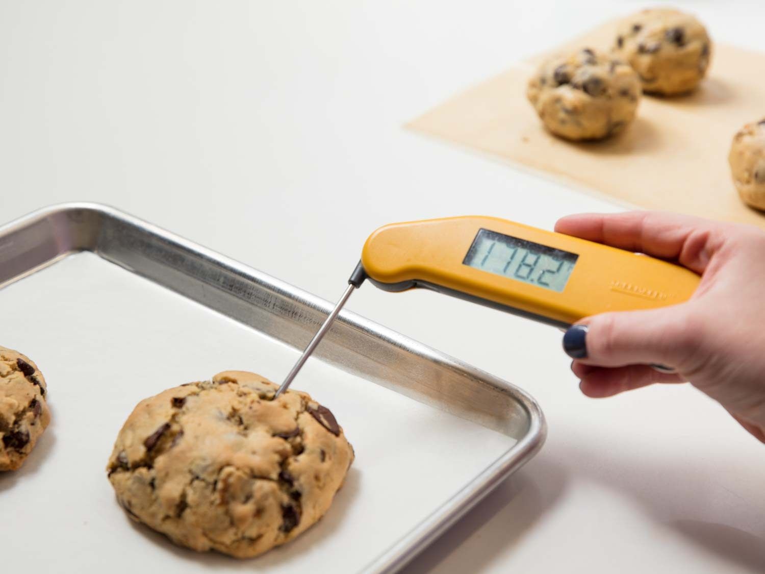 testing a thick cookie with a thermometer