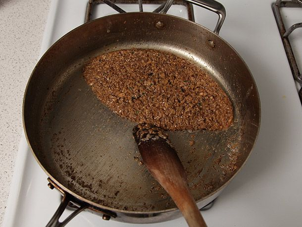 Reduced mushroom duxelles in a saute pan for beef Wellington.