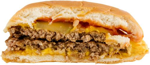 A McDonald's double cheeseburger showing two patties and two slices of cheese.
