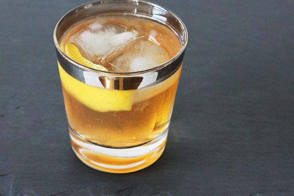 Sazerac and cider cocktail with lemon peel