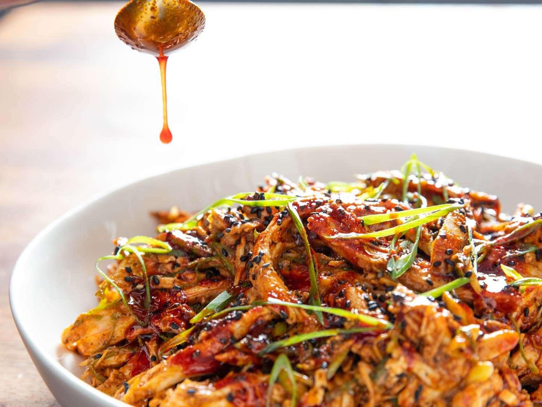 Drizzling extra chili oil over a bowl of Bang Bang Turkey.