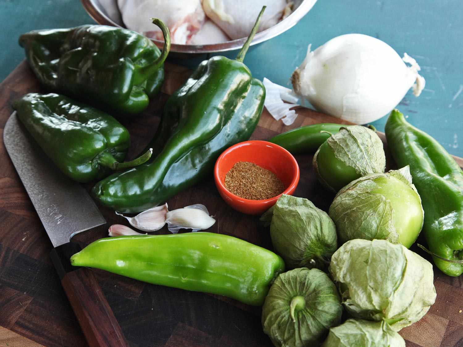 Green chiles, tomatillos, garlic, and spices for chicken green chili (chile verde).